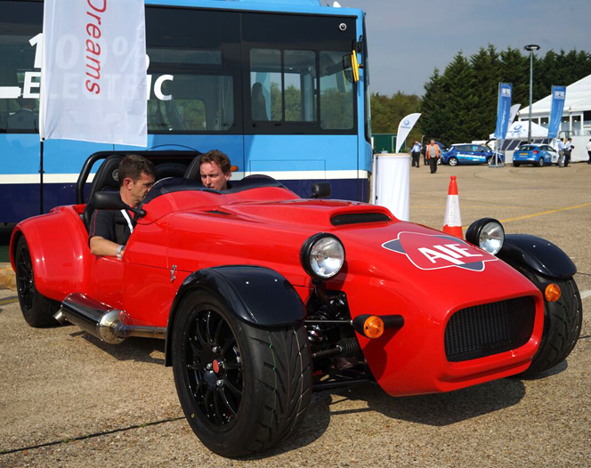 A red color British made sports car powered by a single rotor rotary engine with AIE logo